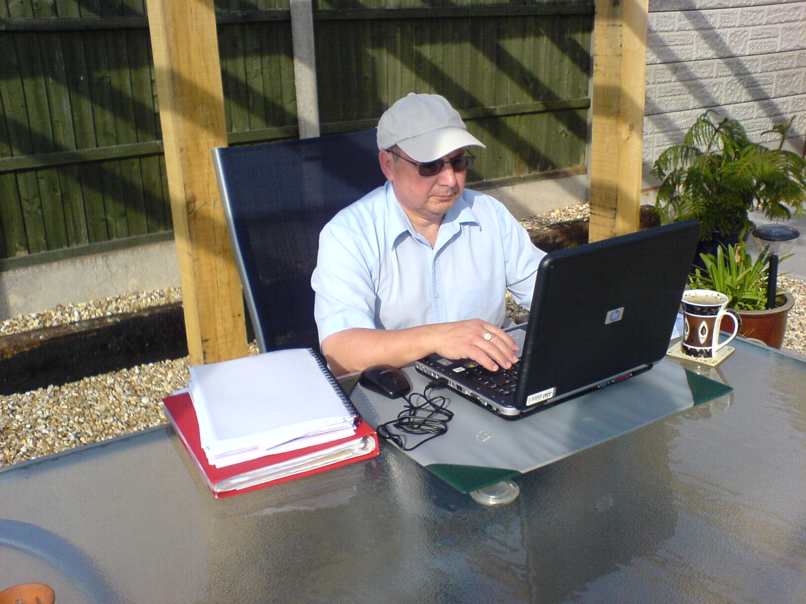 03-09-05 Jim on Laptop in garden